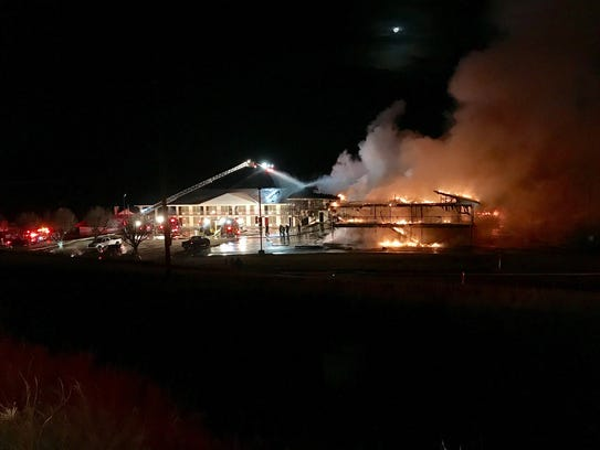 Flames engulf the Red Roof Inn off Sangers Lane near