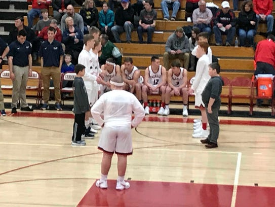 Pacelli players get ready for pregame introductions of the starting lineup prior to a nonconference contest with Stratford on Saturday night.