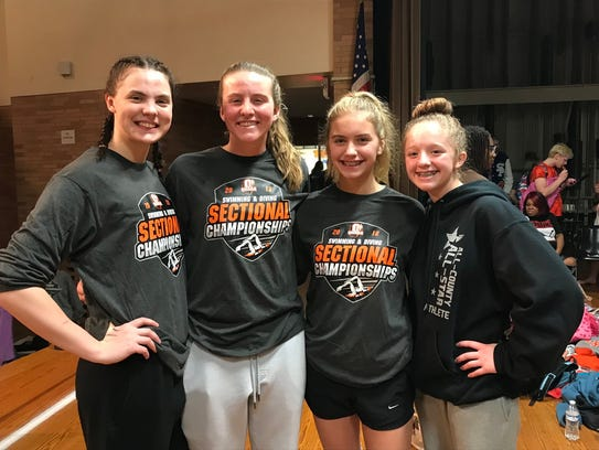 The Colonel Crawford quartet of, left to right, Jillianne Gregg, Pierce Krassow, Cassidy Vogt and Kaisey Speck set sectional meet and pool records in the 200 free relay and also won the 200 medley, just off the record time.