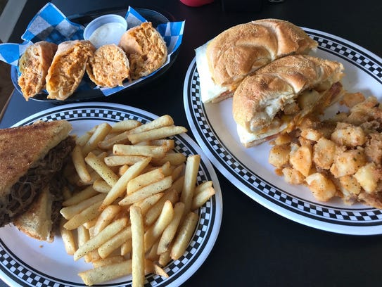 Buffalo chicken egg rolls, a pork roll sandwich, and