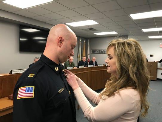Newly-sworn Oakland Capt. Keith Sanzari receives his