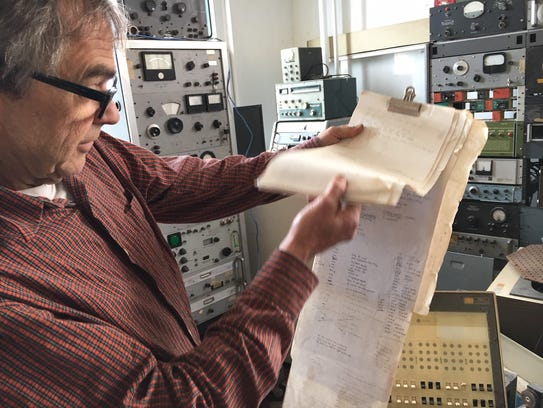 John Tinker at work in the nerve center of the radio station he wired together in an old school house in Fayette, Missouri.