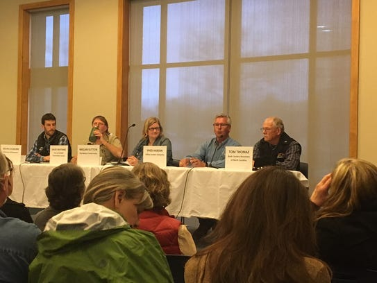 Panelists at the MountainTrue event discussing the