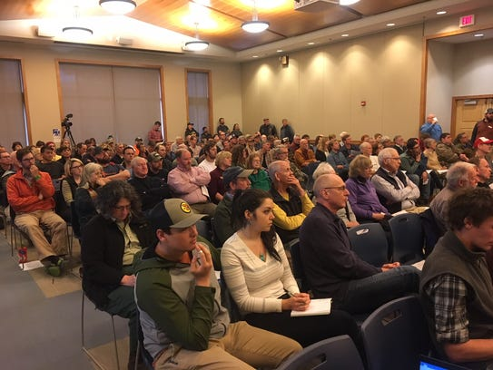 Some 200 people packed the Transylvania County Library