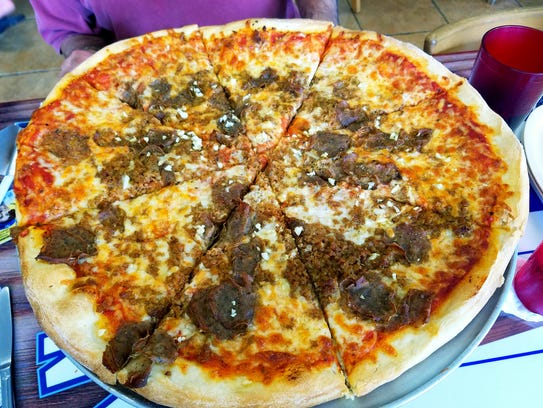 Bobby's Pizza's New York-style pizza topped with meatballs,