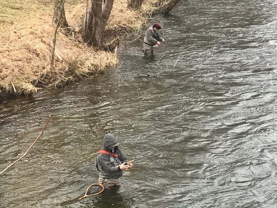 Wading into the chilly waters of the Ramapo in search