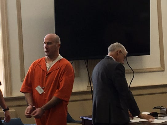 Admitted robber Michael Conway, with defense lawyer