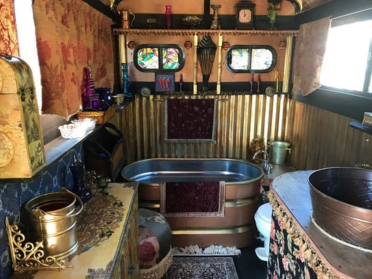 A repurposed horse trough serves as a bathtub in a tiny trailer home created by landscape architect David Carlyle of Naples.