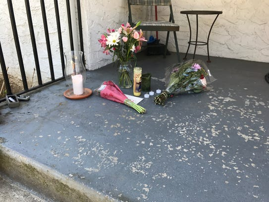 Candles and flowers have been left on the doorstep