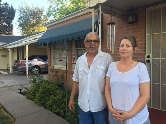 Frank and Shawn Ortega pictured in front of the house