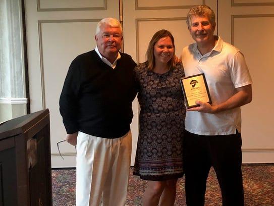 Kathy and Mark Marandola of Marandola's in Bradley Beach accept their award from Jim Flynn (left), chairman of ShoreFoodie.com.