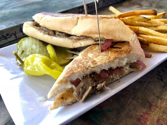 A pressed pulled pork sandwich from Shark Bar & Grill