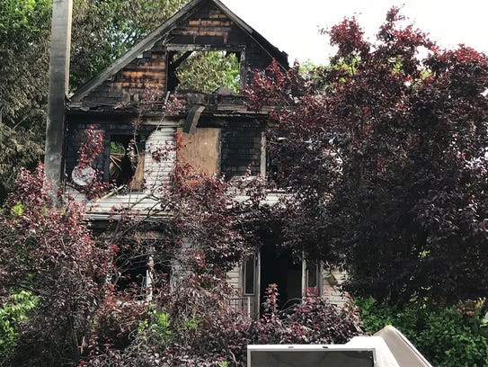 A neighbor said the landscaping was so overgrown firefighters