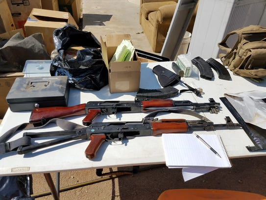 Detectives found several illegal rifles and large capacity