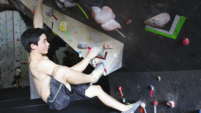 Brian Huang scales a wall at the Tallahassee Rock Gym when he was 14.