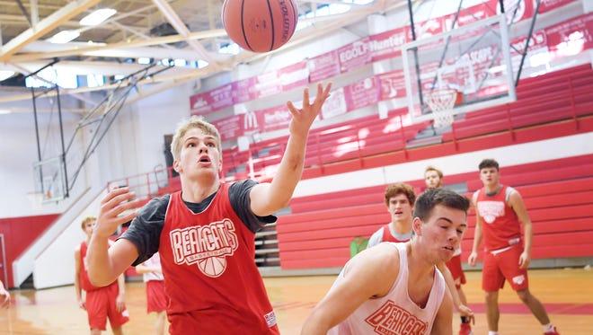 Hendersonville junior basketball player Ben Beeker reaches for a rebound during practice December 14, 2017.
