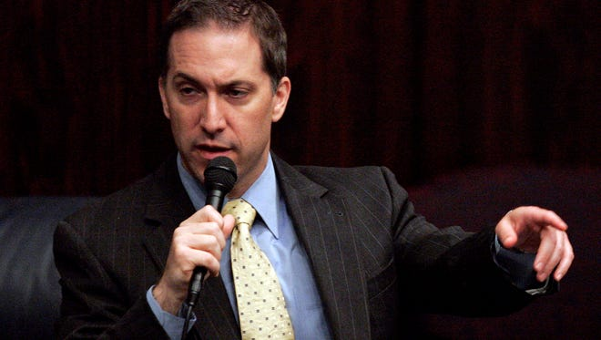 Former Sen. Dave Aronberg, D-Greenacres, and current state attorney for Palm Beach County, asks a questions about the red light camera bill during a senate session April 27, 2010 in Tallahassee.