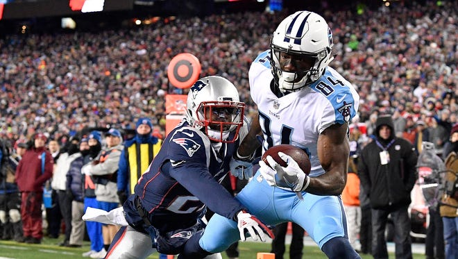 Tennessee Titans wide receiver Corey Davis (84) scores a touchdown against New England Patriots cornerback Malcolm Butler (21) during the first half of the AFC Divisional Playoff game at Gillette Stadium.