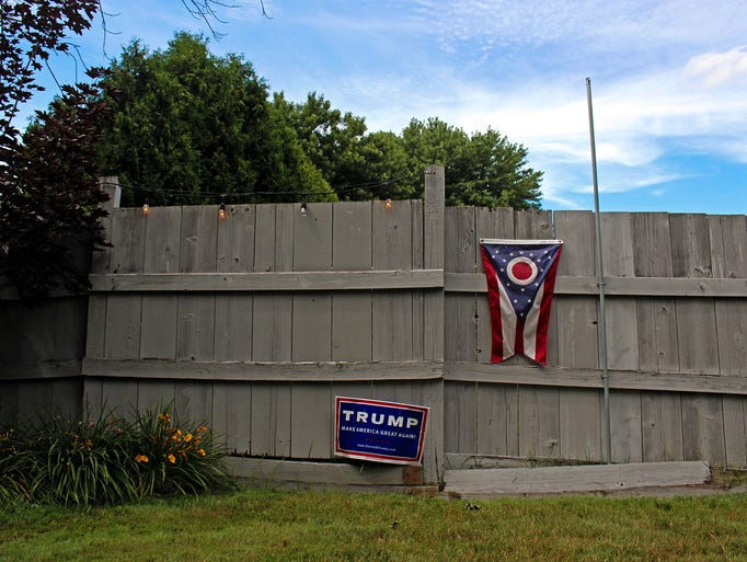 A Donald Trump campaign sign and Ohio state flag decorate