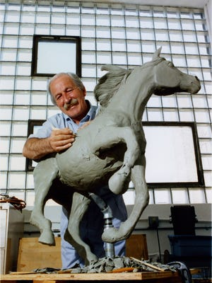 Tom Remo in his studio. Remo's works were included in a special exhibit at Thelma Sadoff Center for the Arts.