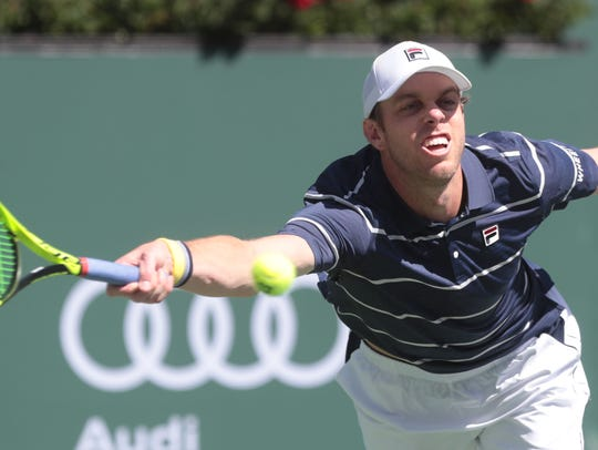 American Sam Querrey stretches to return Canadian,