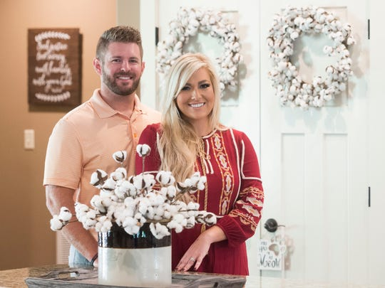 """Andy and Leslie Henry stand in the kitchen of their Louisville, Tenn., home. Leslie's choice of cotton was inspired by the design style of Joanna Gaines, co-host of HGTV show """"Fixer Upper."""""""