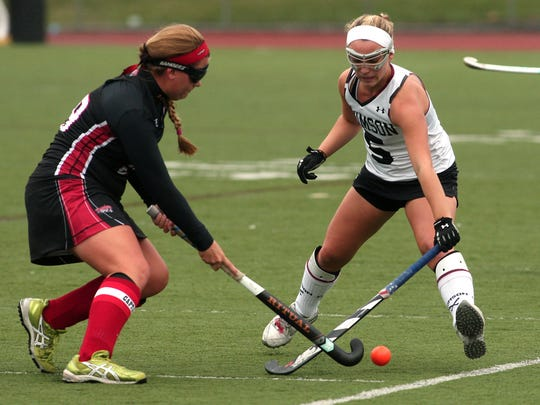 Boonton's Chelsea Davis and Morristown-Beard's Alissa Masini battle for the ball during their  field hockey matchup in the MCT second round. October 3, 2015, Morristown, NJ.