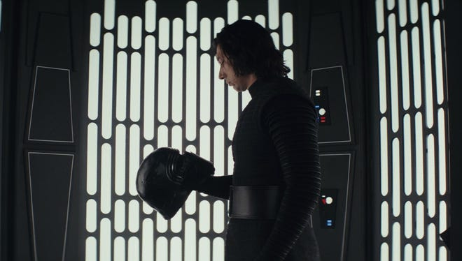 "Adam Driver appears as the character Kylo Ren in a scene from ""Star Wars: The Last Jedi."""
