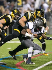 Red Lion's Nick Argento, seen here making a tackle,