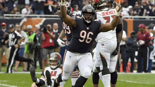 Chicago Bears defensive end Akiem Hicks (96) celebrates after sacking Tampa Bay Buccaneers quarterback Ryan Fitzpatrick (14) during the first half of  Sunday in Chicago. The Bears won 48-10.