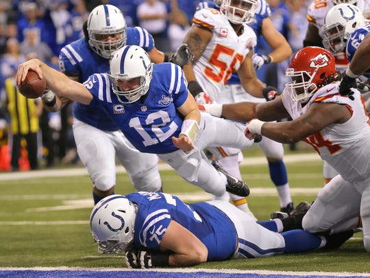 Indianapolis Colts Andrew Luck recovers a fumble from Indianapolis Colts Donald Brown and runs in the ball during the AFC Playoff game against Kansas City Saturday, January 4, 2014 at Lucas Oil Stadium.