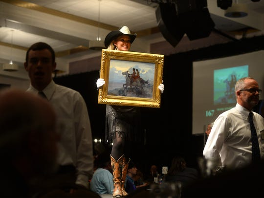"Frank Tenney Johnson's ""Navajos"" sold for $60k at The Russell Auction on Saturday night in the Civic Center."