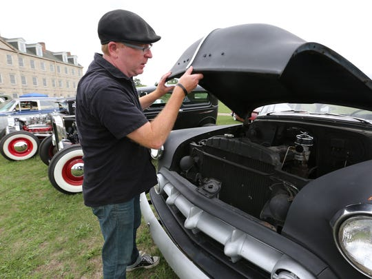Marc Church, 45, of Royal Oak owns a 1953 Chevrolet 210 and is showing it with Suspects, a  Motor Club of Detroit at the Historic Fort Wayne in Detroit Sunday, Aug. 14, 2016.