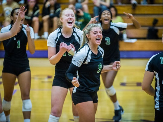 Yorktown celebrates defeating Zionsville at the Muncie Fieldhouse Saturday, Oct. 21, 2017.