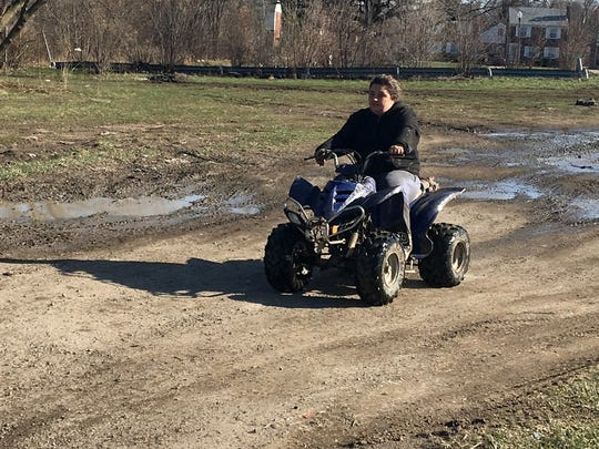 Jenna Blackburn, 31, of Warren rides her ATV at Dorais Playground in Detroit on April 19, 2018. Blackburn said she gets an adrenaline rush from riding. She trailers her 4-wheeler into the park to ride about five times a week.