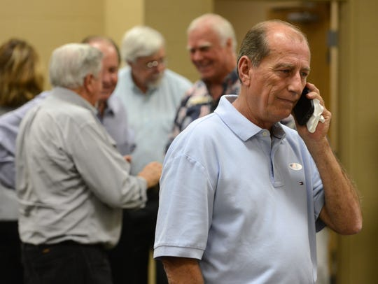 Mayor Guy Thompson talks on the phone in August 2014 after trailing in early voting results to Wesley Meiss, who won the bid for Milton mayor.