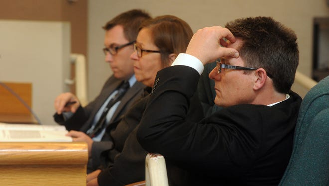 Conejo Valley Unified School District staff members Robert Iezza (right), Linda Bekeny and Mark McLaughlin listen as members of the community address the district board during a 2014 meeting.