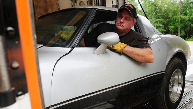 Mark Fortney, with Reliable Carriers Inc., drives the 1979 Corvette belonging to Detroit resident George Talley onto a truck Saturday morning at the Mississippi Highway Patrol Troop J Office. The Corvette since has been returned to Talley 33 years after it was stolen.