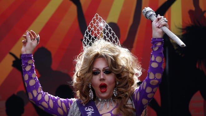 Richard Stevens, 42, of Phoenix, Miss Phoenix Gay Pride, performs Saturday, Oct. 18, 2014, during the Rainbows Festival in Phoenix. Stevens' stage name is Barbra Seville.