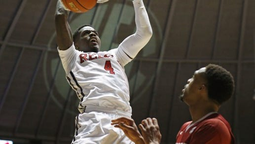 Mississippi forward M.J. Rhett (4) dunks against Arkansas during the second half of an NCAA college basketball game in Oxford, Miss., Saturday, Feb. 14, 2015. Arkansas won 71-70. (AP Photo/Rogelio V. Solis)