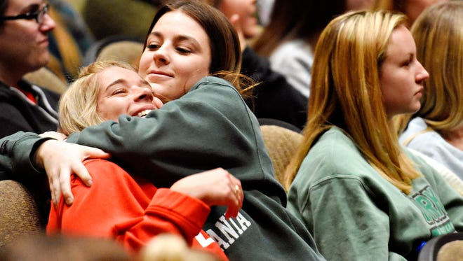 """Lindsay Dowdy, left, is quickly hugged by her neighbor Emily Pupo, as prompted, during an interactive performance by all-female improv troupe, """"No Artificial Sweeteners,"""" during a Take Back the Night event held in Waldner Performing Arts Center at York College of Pennsylvania in Spring Garden Township, Wednesday, April 11, 2018. The event is one of many activities being held during York College's Week of Action, April 9-13, in recognition of Sexual Assault Awareness Month. Dawn J. Sagert photo"""