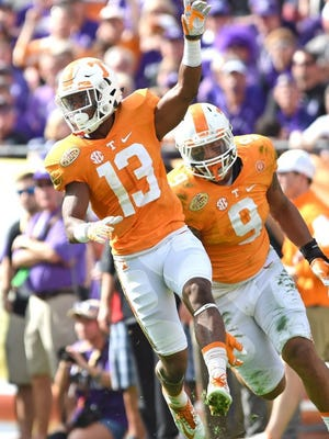 Tennessee defensive back Malik Foreman (13) celebrates after making an interception against Northwestern during the first half of the Outback Bowl at Raymond James Stadium in Tampa, Fla. on Friday, Jan. 1, 2016. (ADAM LAU/NEWS SENTINEL)