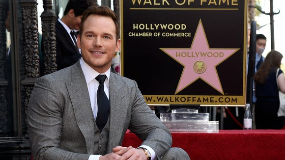 Chris Pratt poses by his star during a ceremony on