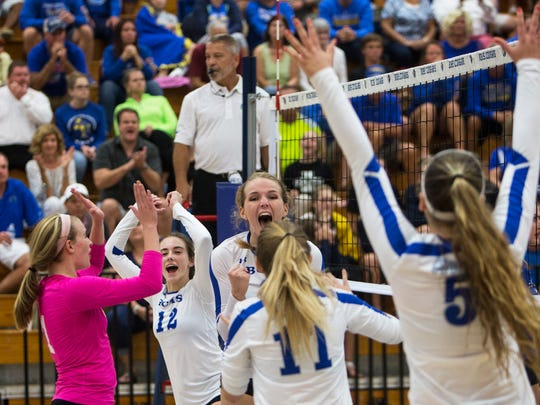 Julie Tanner, #8, center, cheers with her teammates after scoring a point in the Class 7A Regional Championship volleyball game at Barron Collier High School on Tuesday, Nov. 1, 2016 in Naples, Florida. Barron Collier defeated Charlotte 3-0 to secure the championship win.