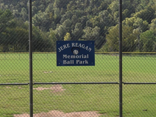 "A 'Jere Reagan Memorial Ball Park"" sign hangs on the backstop of the baseball field at Cotter's Big Spring Park on Saturday. The ball park was named after a longtime Cotter resident and volunteer."