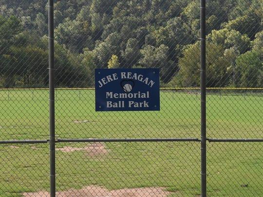 "A 'Jere Reagan Memorial Ball Park"" sign hangs on the"