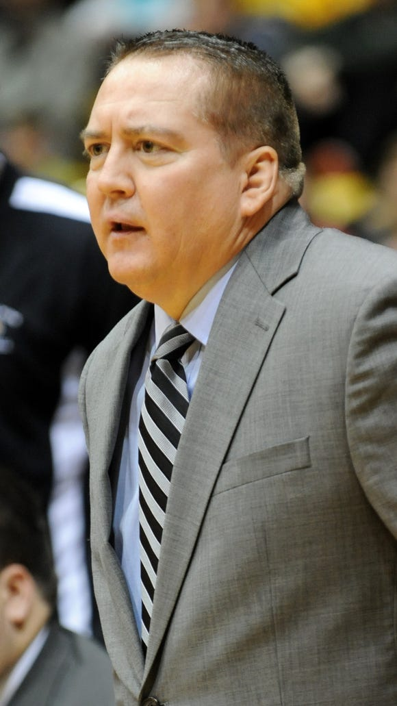 In this file photo, former Southern Miss head coach Donnie Tyndall watches from the sidelines as Southern Miss takes on FIU.