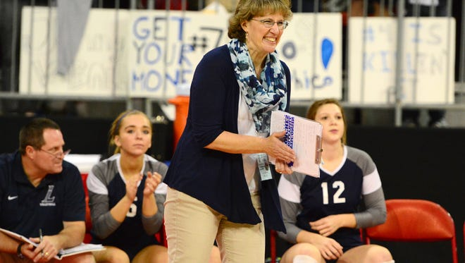 Lake Country Lutheran head coach Janet Bahr reacts from the bench against Waterloo during the Division 3 championship match in 2015. Bahr is one of the rare athletic directors in the area who remains able to coach.