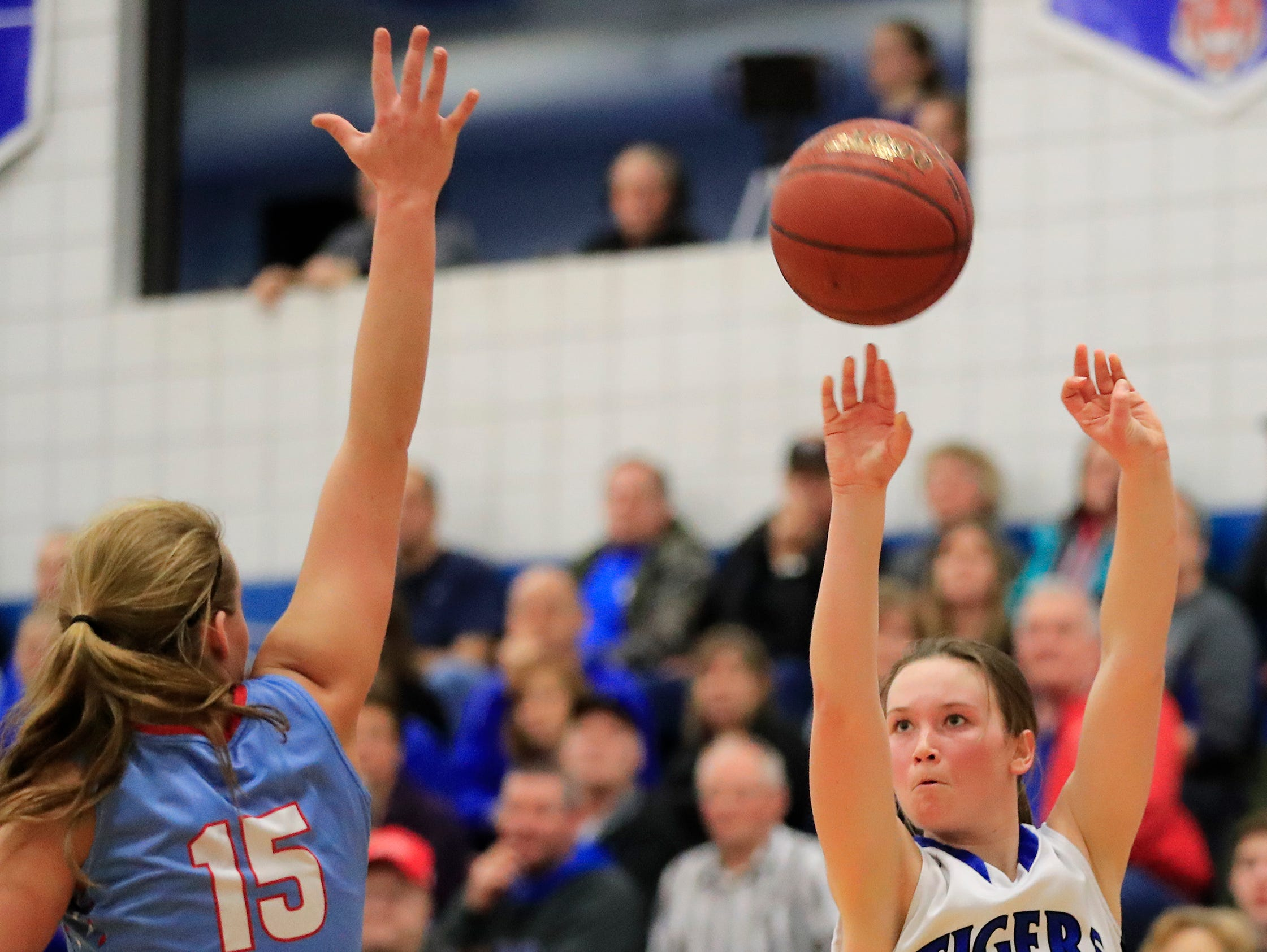 Wrightstown freshman Bridget Froehlke (1) shoots a 3-pointer against Southern Door's Megan Pavlik (15) in a WIAA Division 3 regional final girls basketball game on Feb. 27. Froehlke leads the Tigers with 44 made 3-pointers this season.