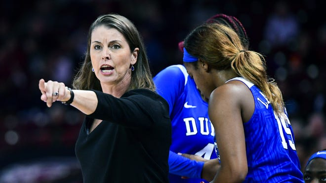 "FILE - In this Dec. 19, 2019, file photo, Duke coach Joanne P. McCallie communicates with players during the second half of the team's NCAA college basketball game against South Carolina, in Columbia, S.C. McCallie won't return for a 14th season as Duke's women's basketball coach. McCallie announced her departure in a 6-minute video posted Thursday, July 2, 2020, on the program's Twitter account. She said she was ""choosing to step away"" as coach, saying she wanted to bring ""clarity"" instead of uncertainty as she entered the final year of her contract."